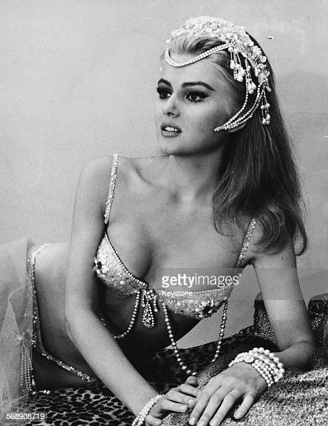 Portrait of actress Pamela Tiffin wearing a diamantine bikini and headdress as she appears in the film 'Paranoia' Rome October 1965