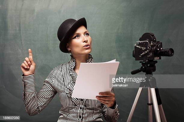 portrait of actress reading script behind camera - actress stock pictures, royalty-free photos & images