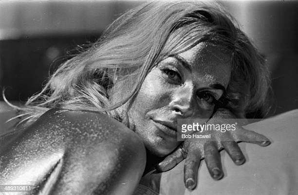 Portrait of actress Shirley Eaton painted gold on the set of the James Bond film 'Goldfinger' April 20th 1964