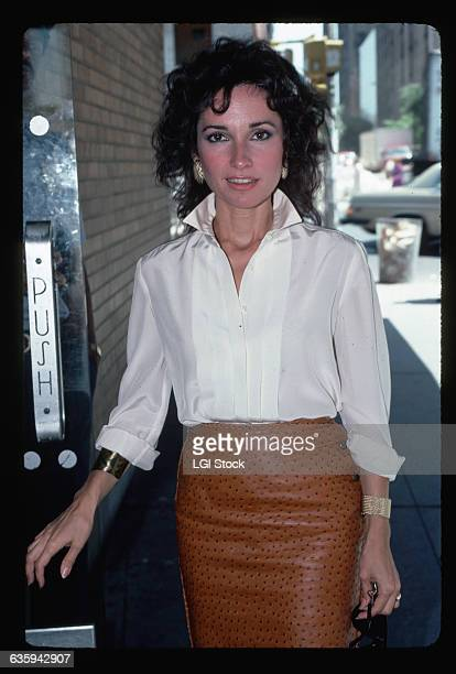 Portrait of actress Susan Lucci She is shown waistup entering a New York building Undated photograph circa 1980's