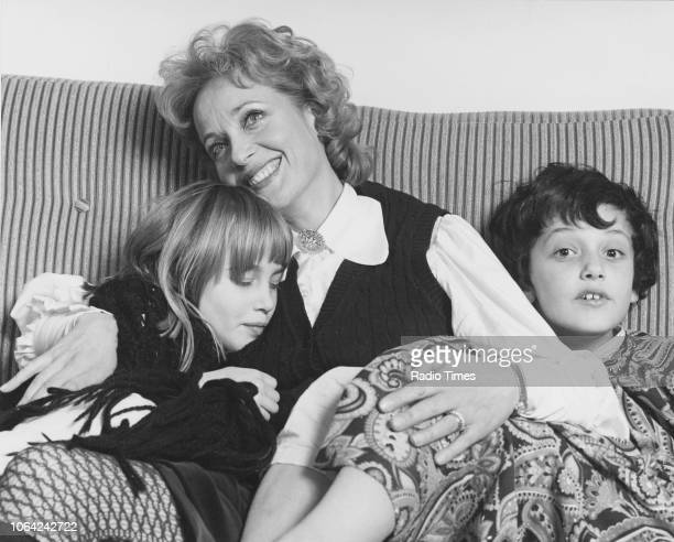 Portrait of actress Sylvia Syms and her two children November 1971