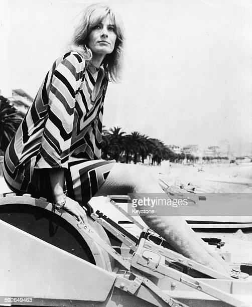 Portrait of actress Vanessa Redgrave sitting on the beach wearing a chevron patterned dress as she bring her film 'Blow Up' to the Cannes Film...