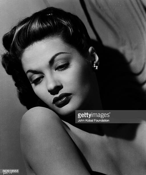 Portrait of actress Yvonne De Carlo wearing an off the shoulder dress for Universal Pictures 1945