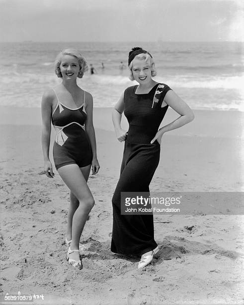 Portrait of actresses Bette Davis and Joan Blondell on a beach as they appear in the film 'Three on a Match' for Warner Bros Studios 1932