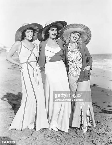 Portrait of actresses Frances Dee Adreienne Ames and Judith Wood arm in arm on the beach All actresses had signed contracts with Paramount studios...