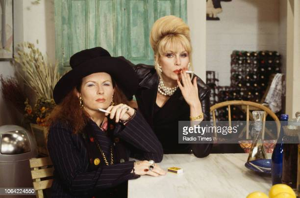 Portrait of actresses Jennifer Saunders and Joanna Lumley smoking cigarettes on the set of the television sitcom 'Absolutely Fabulous' May 21st 1993