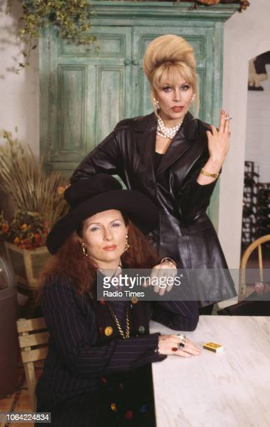Portrait of actresses Jennifer Saunders and Joanna Lumley smoking cigarettes on the set of the television sitcom 'Absolutely Fabulous', May 21st 1993.