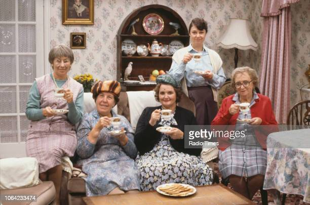 Portrait of actresses Juliette Kaplan Kathy Staff Jane Freeman Sarah Thomas and Thora Hird drinking tea on the set of the BBC television sitcom 'Last...