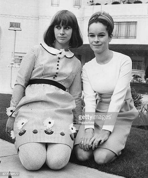Portrait of actresses Rita Tushingham and Geraldine Chaplin kneeling on the grass during a break from their press conference to promote the new film...