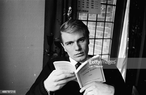 Portrait of Adam Faith reading the book 'Veritable Diseases in the Very Young' March 5th 1964