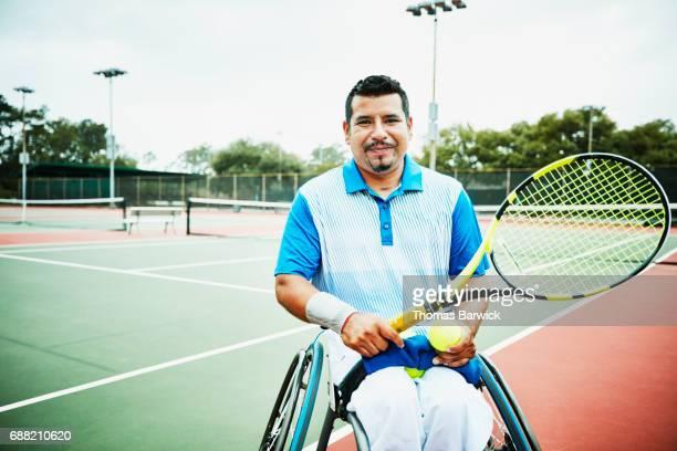 portrait of adaptive athlete preparing to play wheelchair tennis - 車いすテニス ストックフォトと画像