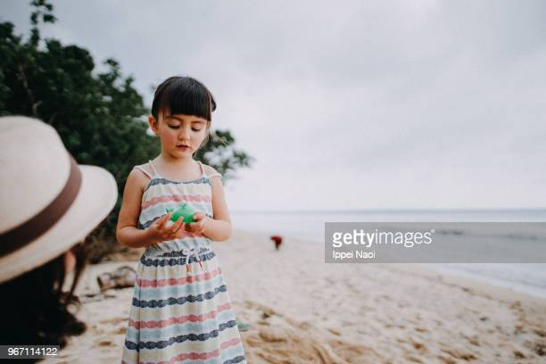 Portrait of adorable mixed race little girl on beach