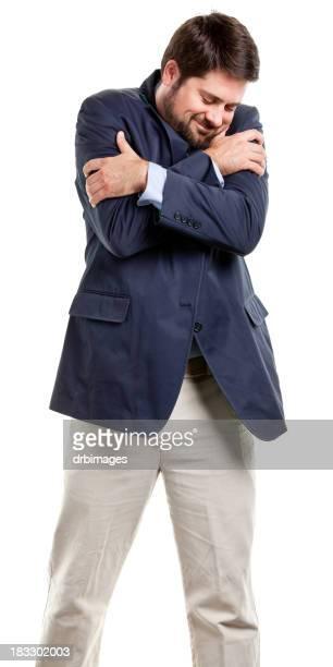 portrait of adult male hugging himself - 僅一男人 個照片及圖片檔