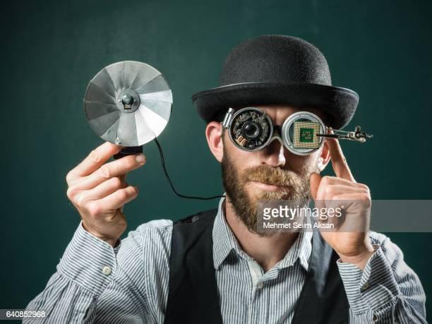 Portrait Of Adult Man Wearing A Bowler Hat And Handmade Smartglasses
