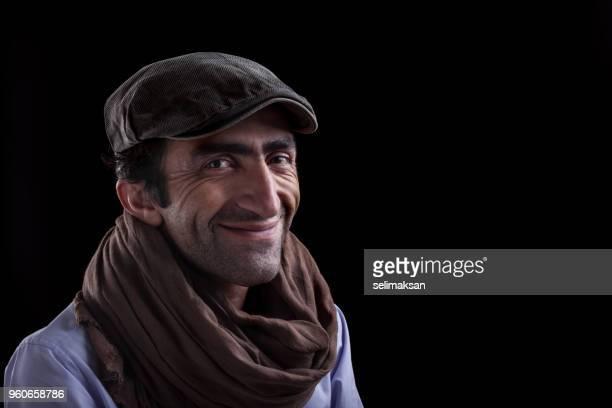 Portrait Of Adult Man Wearing A Flat Cap