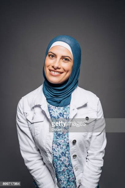 Portrait of adult Middle Eastern woman with headscarf in Australia