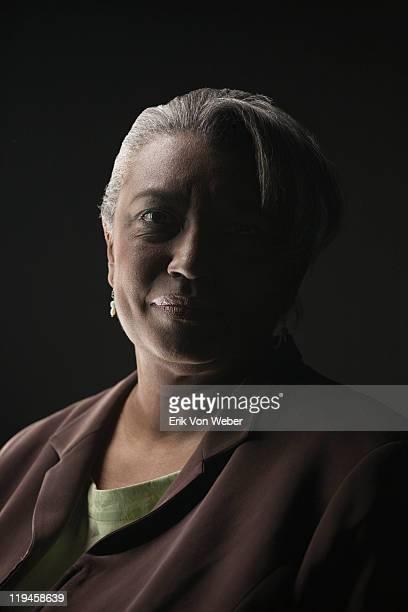 portrait of adult on black background - clave baja fotografías e imágenes de stock
