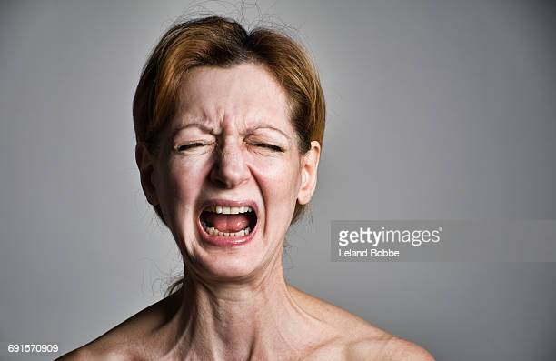 Portrait of adult woman screaming in rage