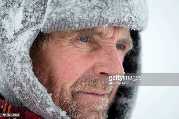 Portrait of Adventure Mauntain Senior Man, Snowing, Julian Alps, Europe