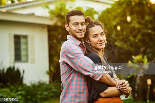 portrait of affectionate couple in back yard - casal heterossexual imagens e fotografias de stock
