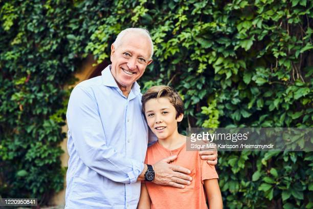 portrait of affectionate grandfather and grandson - generation gap stock pictures, royalty-free photos & images