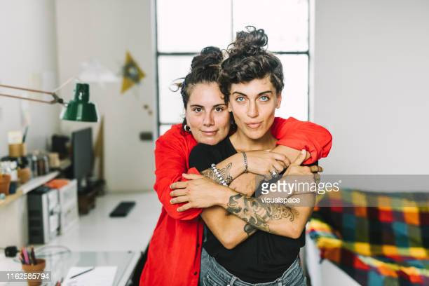 portrait of affectionate homosexual couple at home - lgbtq  and female domestic life stock pictures, royalty-free photos & images