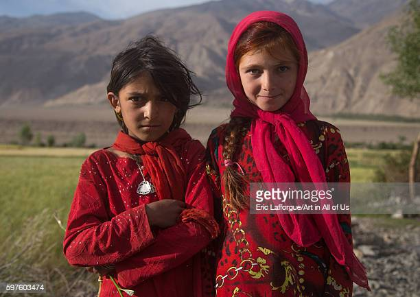 Portrait of afghan girls dressed in red clothes badakhshan province qazi deh Afghanistan on August 14 2016 in Qazi Deh Afghanistan