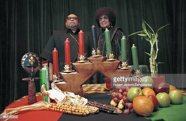 Portrait of African American author activist and professor Maulana Karenga with his wife Tiamoya celebrating Kwanzaa ca2000 Karenga created the...