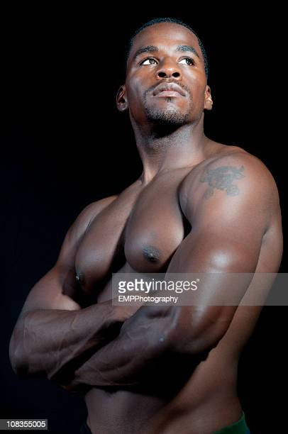 portrait of african american  bodybuilder isolated on black - shirtless stock pictures, royalty-free photos & images