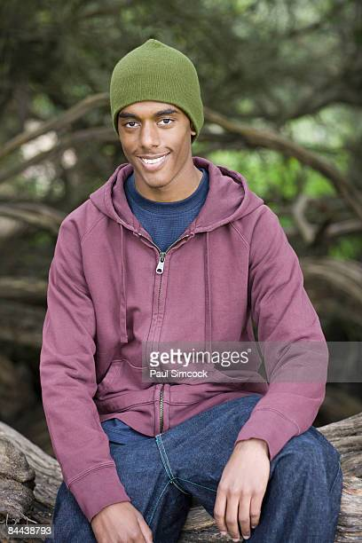 Portrait of African American male youth in park
