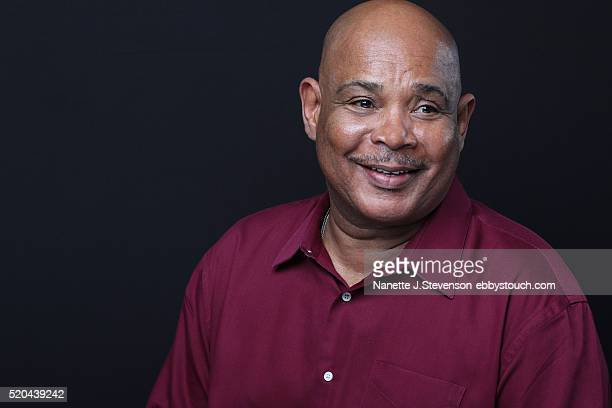 portrait of african american man on dark background - nanette j stevenson stock photos and pictures