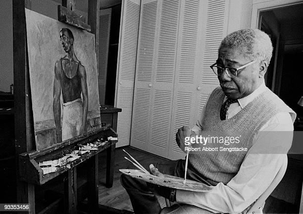 Portrait of African American painter Aaron Douglas , long time professor at Fisk University, and a leading figure in the Harlem Renaissance, painting...