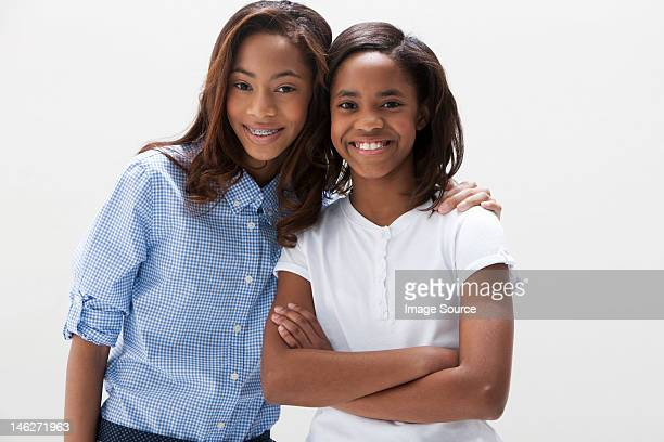 Portrait of African American sisters, studio shot