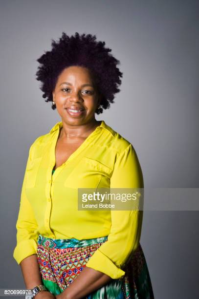 portrait of african american woman - black blouse stock pictures, royalty-free photos & images