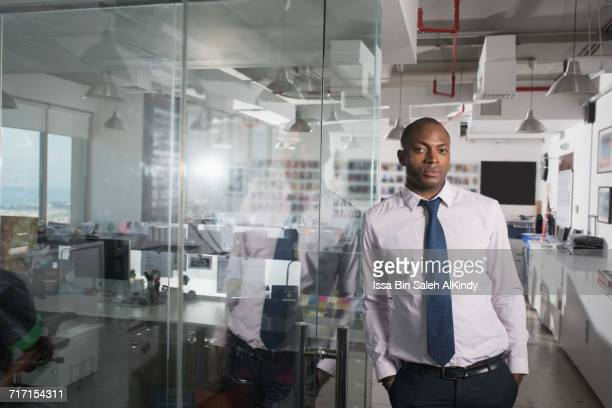 portrait of african businessman at the office - nigerian men stock photos and pictures