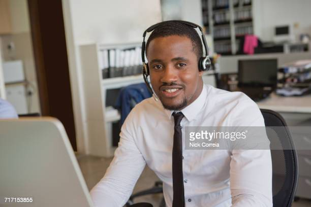 Portrait of African businessman wearing headset in the office