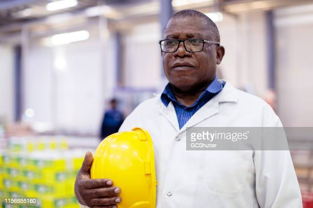 portrait of african factory manager - working seniors stock pictures, royalty-free photos & images