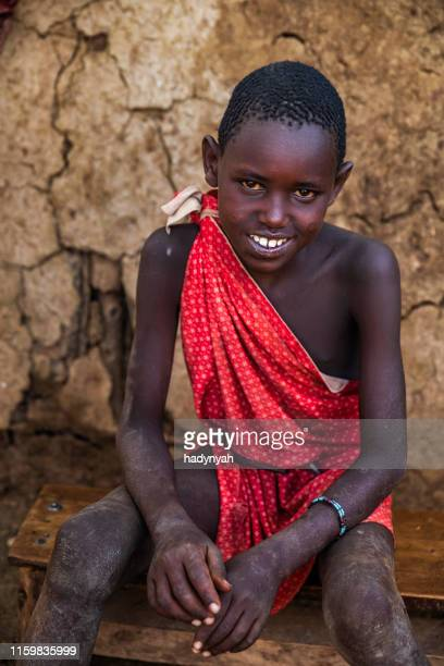 portrait of african little boy on savanna, east africa - eastern african tribal culture stock photos and pictures