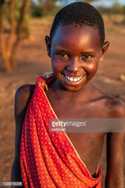 portrait of african little boy on savanna, east africa - east african tribe stock pictures, royalty-free photos & images