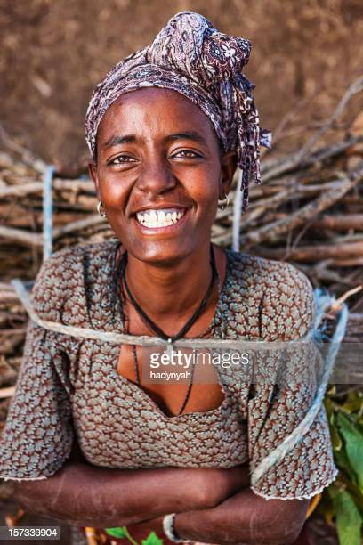 Portrait of  African woman carrying wood, East Africa
