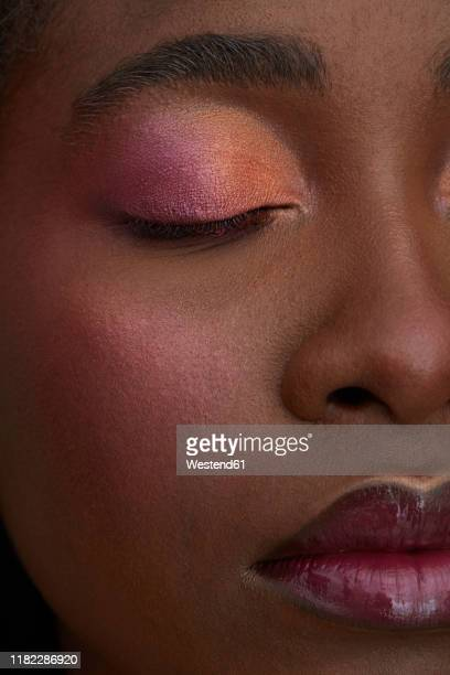 portrait of african woman, closed eye, close-up, made up - blusher stock pictures, royalty-free photos & images