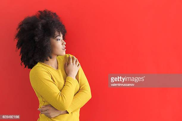 Portrait of african woman on red background