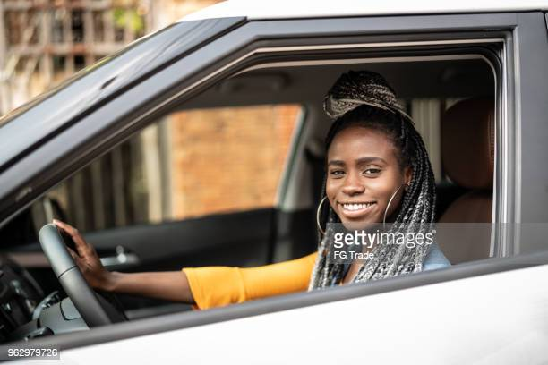 Portrait of African Woman Sitting In Car