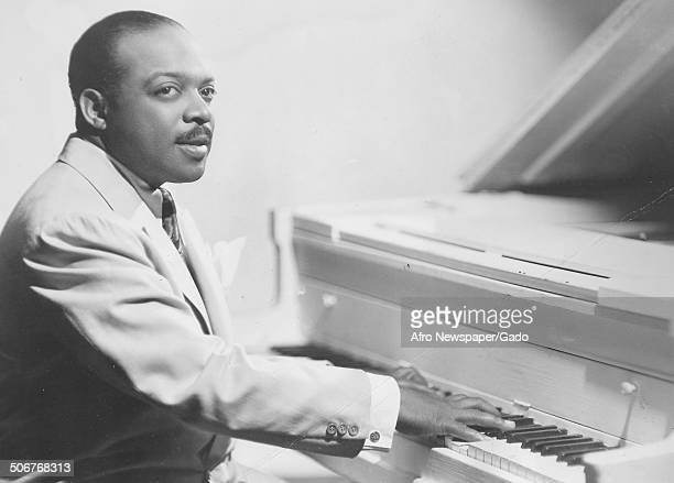 Portrait of AfricanAmerican jazz musician Count Basie playing the piano 1945