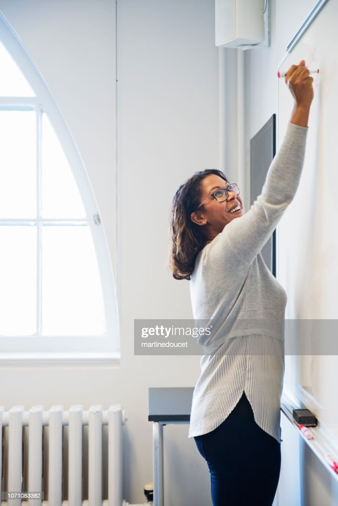 Portrait of African-American woman teaching in College classroom. : Stock Photo