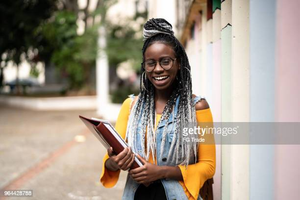portrait of afro student - girl nerd hairstyles stock photos and pictures