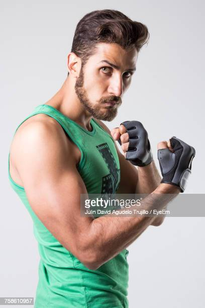 Portrait Of Aggressive Boxer Standing Against White Background