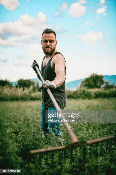 Portrait Of Agriculture Worker In Green Hay Fields