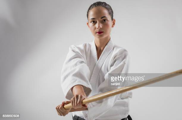 Portrait of Aikido Warrior Holding Bokken Sword