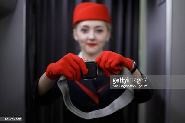 portrait of air stewardess giving instruction - instructions stock pictures, royalty-free photos & images